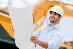 man needing help with construction law looking at building map