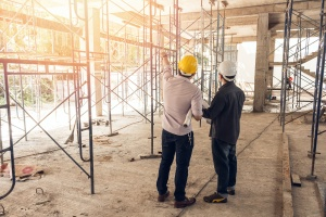 two men looking at building with Construction Law