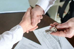shaking hands with a Real Estate & Land Use attorney