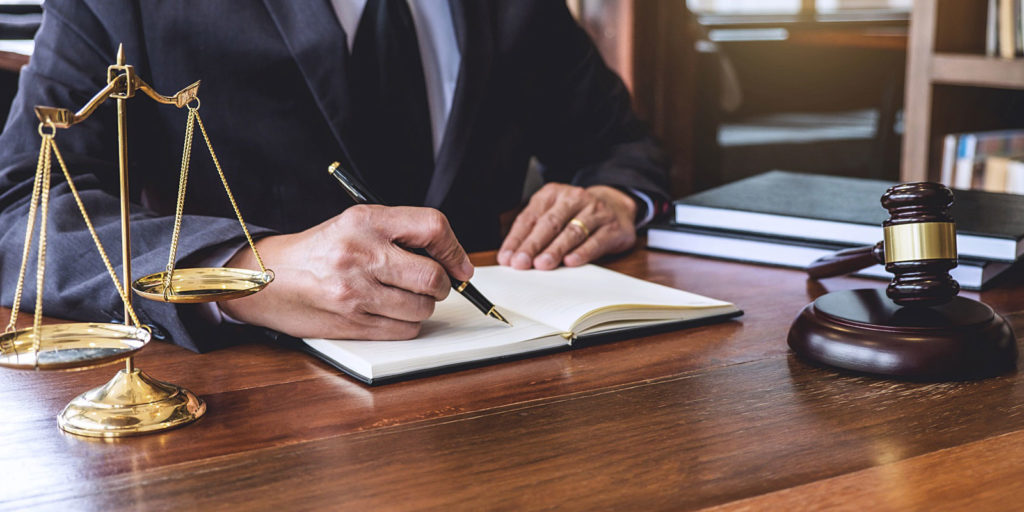a trusts & estates attorney helping a senior citizen plan and draft his will