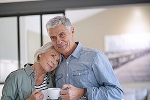 an elderly man an woman sharing tea as they prepare to write their estate plans with an estate planning lawyer
