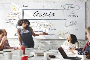Woman establishing overall business goals for succession planning
