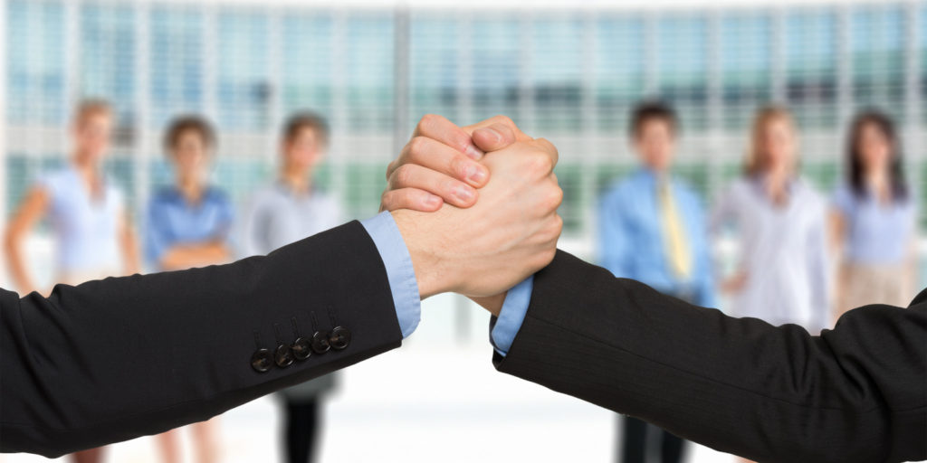 two business people shaking hands symbolizing a joint venture